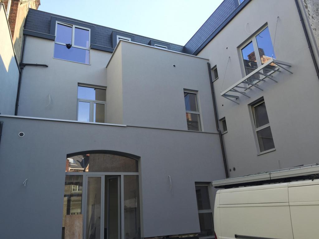 - Finished rear façade