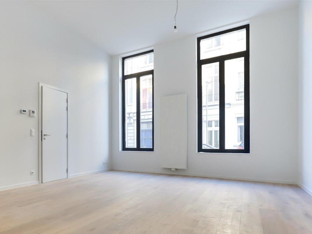 - Leefruimte appartement 1